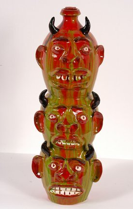 10: Randy Tobias.  Three Devil Face Totem Jug.