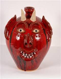 A.V. Smith. Red Devil Face Jug.