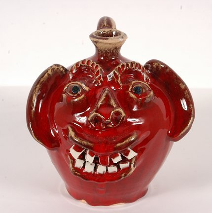 13: Ben Allman.  Small Red Smiling Face Jug.