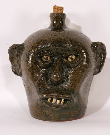 22: Lanier Meaders.  China Plate Teeth Face Jug.