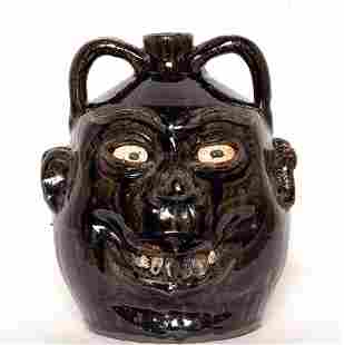 Lanier Meaders. Double Face Rock Tooth Jug.
