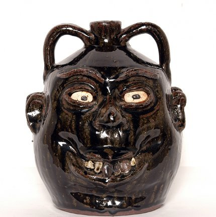 23: Lanier Meaders. Double Face Rock Tooth Jug.