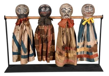 Four Knockdown Spinner Dolls.