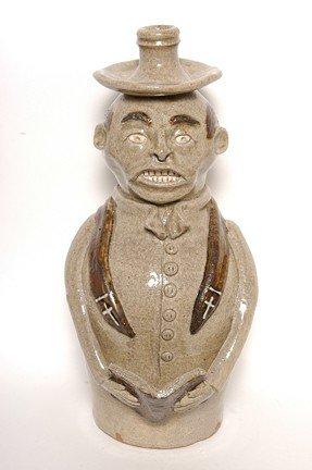 20: Michel Bayne Preacher Bottle Jug.