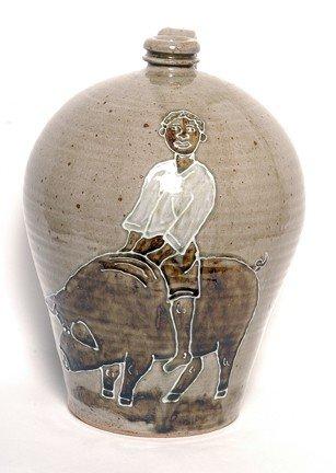 21: Michel Bayne Man Riding Pig Jug.