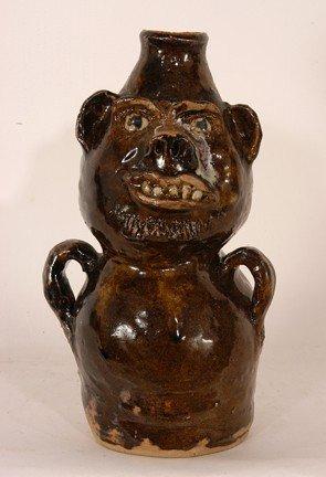 9: Marie Rogers Brown Totem Face Jug.
