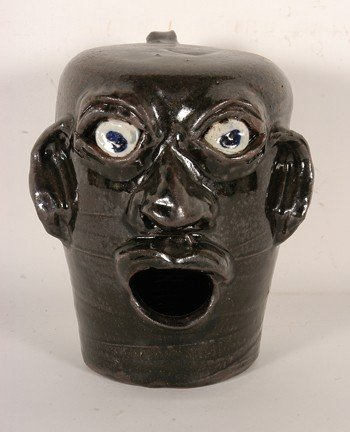 17: Grace Nell Hewell Birdhouse Face Jug.