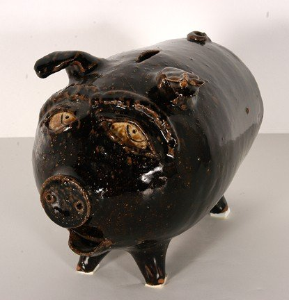 18: Eric Hewell Piggy Bank w Fly Decoration.