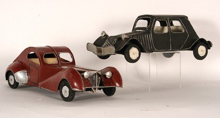 1072: Two Folky Tin Car Models.