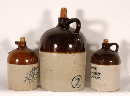 R.M.  Rose Distillers.  3 Brown-Top Jugs.