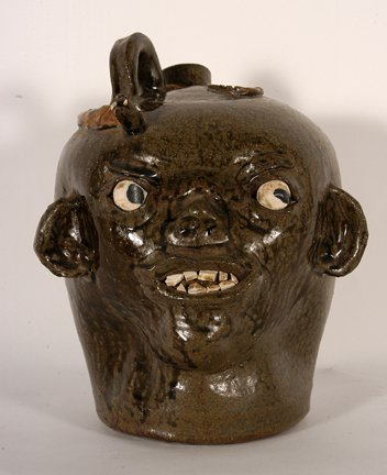 Chester Hewell.  Early Monkey Spout Face Jug.
