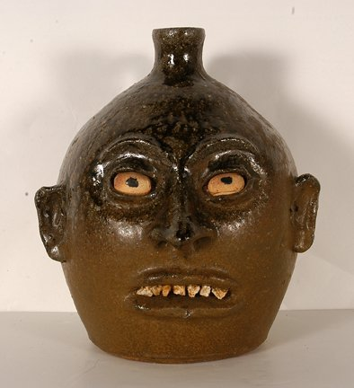 24: Lanier Meaders.  Canon Ball Rock Tooth Face Jug.