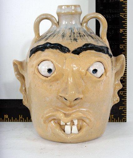 12: A. Teague Yellow Face Jug