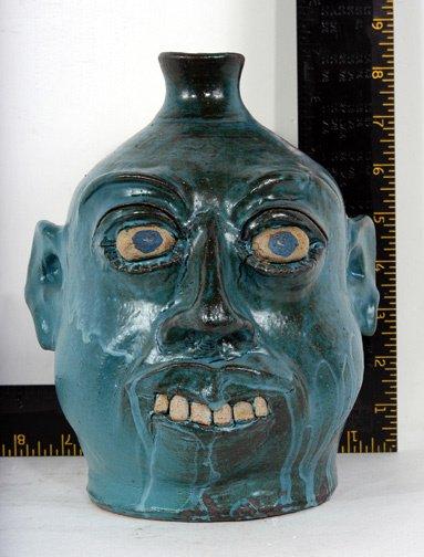13: Henry Freeman Blue Face Jug