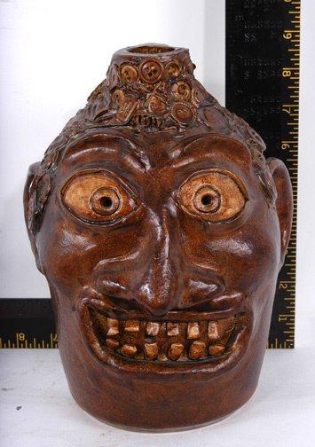 18: Robert Jackson Bronze Memory Style Jug