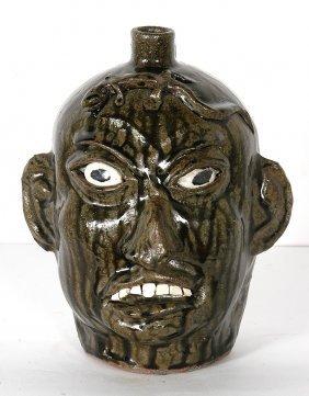 Chester Hewell. Lizard Face Jug.