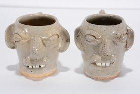 B.b. Craig. Pair Of Small Face Mugs.
