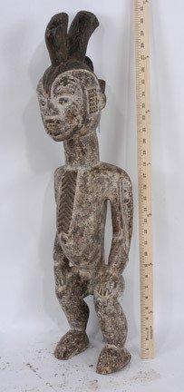 11: Seated Idoma Male Figure