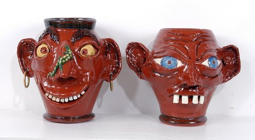 20: Jeff White Pair of Redware Face Crocks