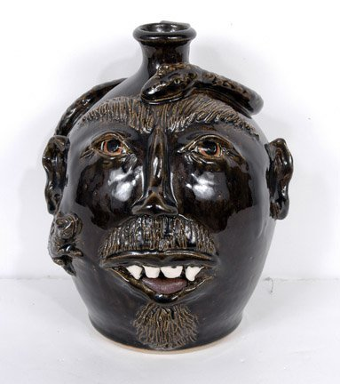 22: J's Pottery Black Face Jug with Snake and Lizard