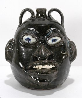 Chester Hewell. Double-Face Negro-Style Jug.