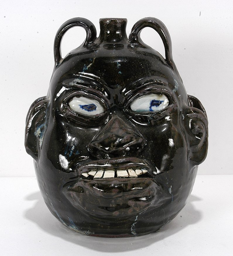 Chester Hewell. Double-Face Negro-Style Jug. - 2