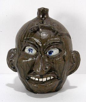 Chester Hewell. Face Jug With Lizard.