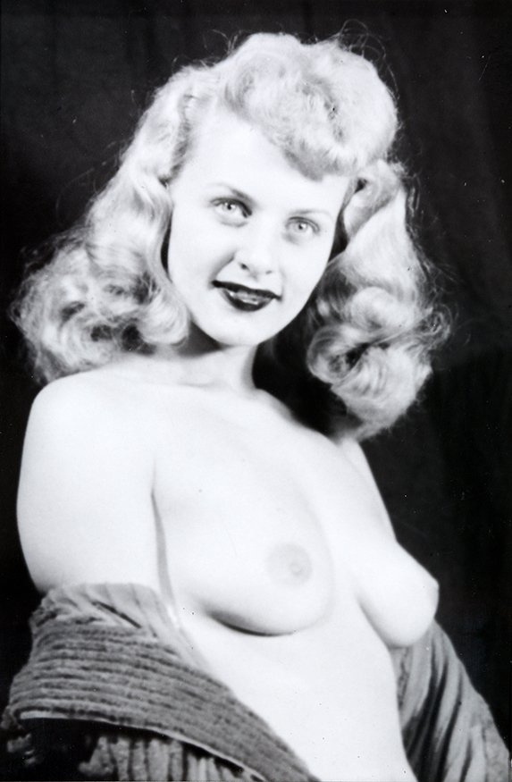 Photograph of Topless Woman Looking at Camera.