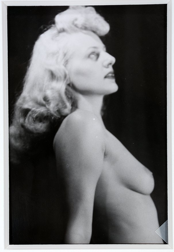 Photograph of Topless Woman Gazing Upward.