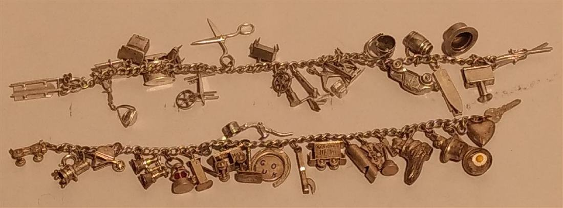 2 Sterling Silver Charm Bracelets. Over 40 charms.