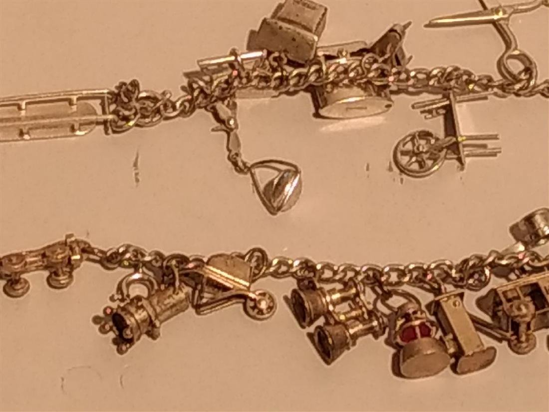 2 Sterling Silver Charm Bracelets. Over 40 charms. - 2