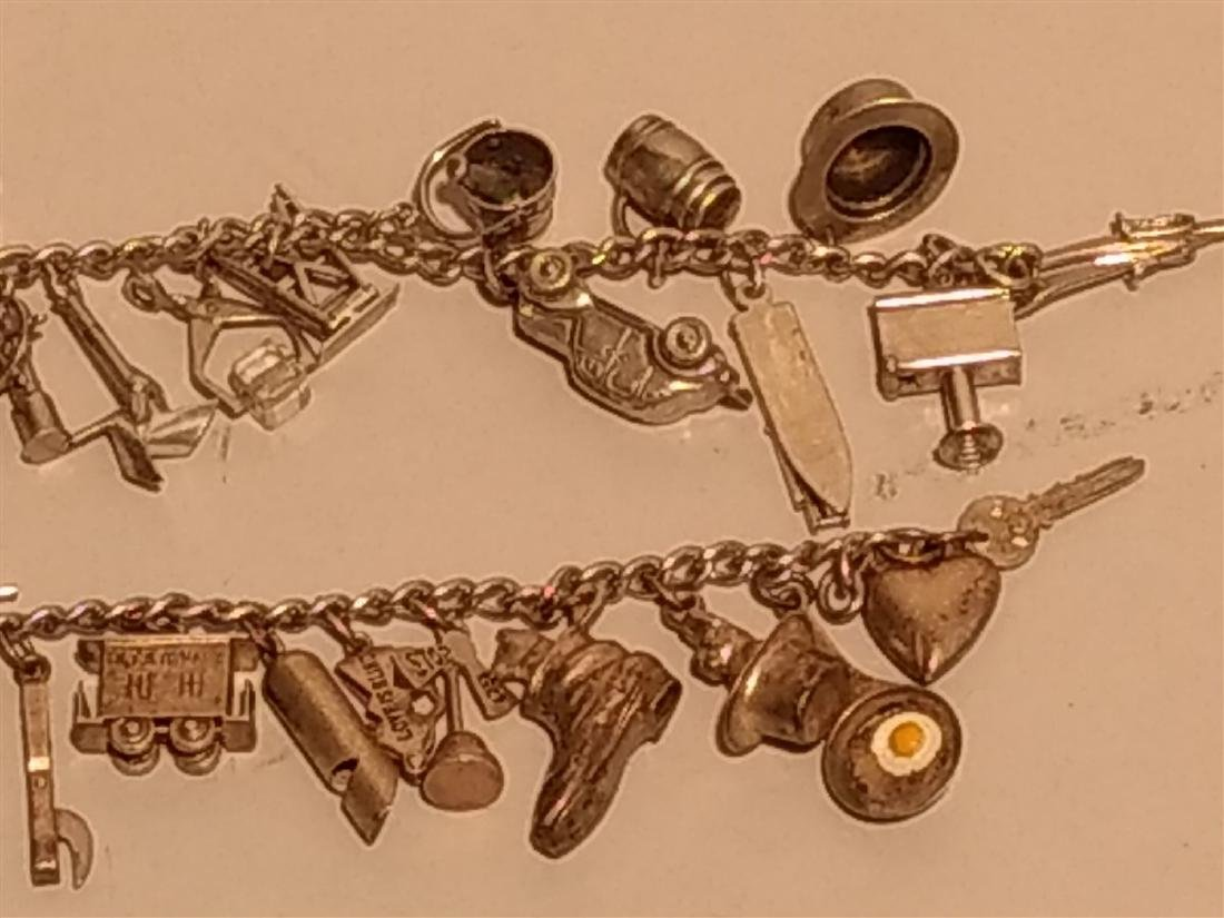 2 Sterling Silver Charm Bracelets. Over 40 charms. - 4