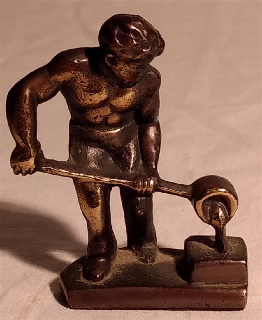 Bronze Blacksmith Pouring a Cast Paperweight