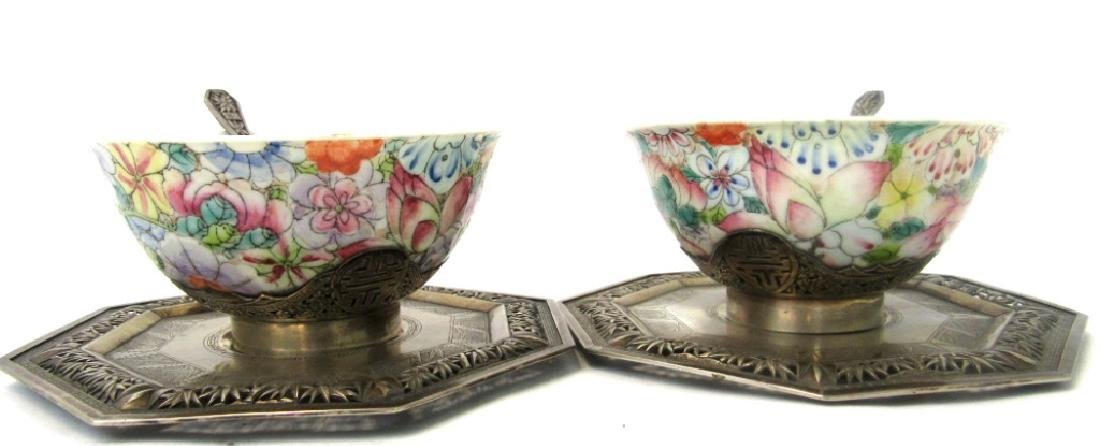 Set of Two Chinese Porcelain Teacups on Silver