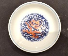 """An Iron-Red-Decorated BLue and White """"Dragon"""" Dish"""