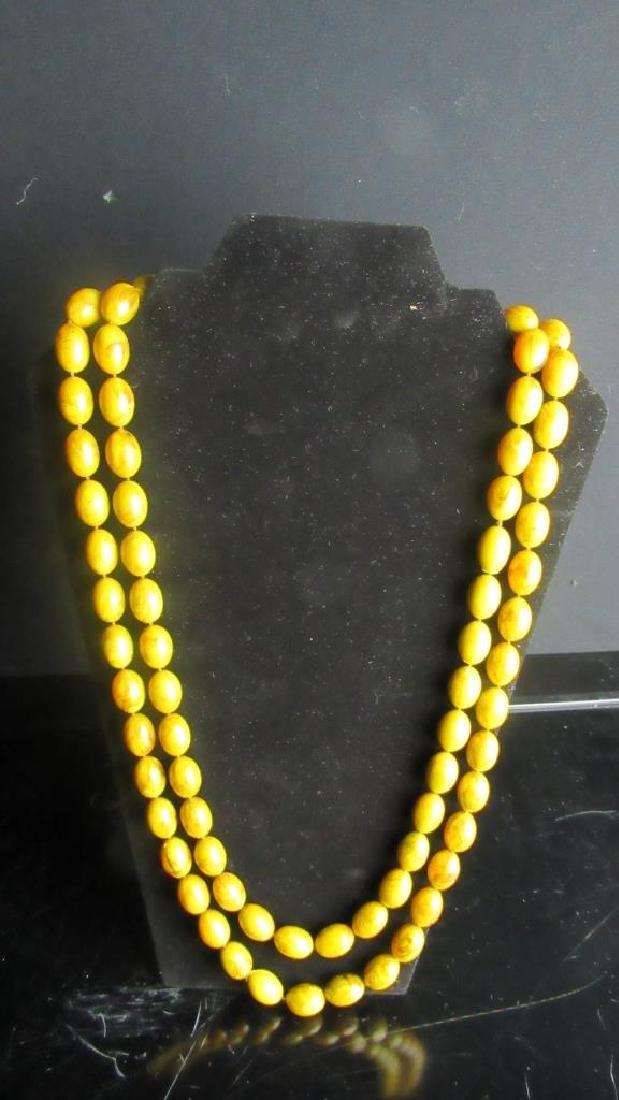 Amber Bead Buddha Necklace