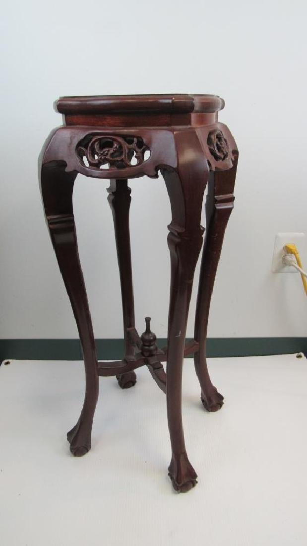 carved rosewood plant stand with a marble inlaid .