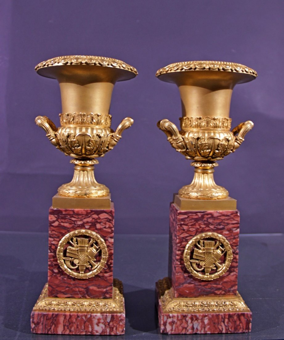 A pair of gilded  bronze vases