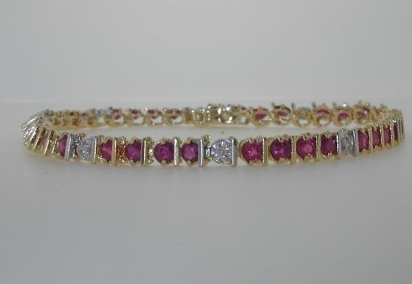 7: 5 CT DIA AND RUBY 14K 10GR