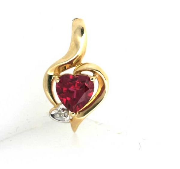 3022: 0.10CT DIA AND LAB RUBY HEART