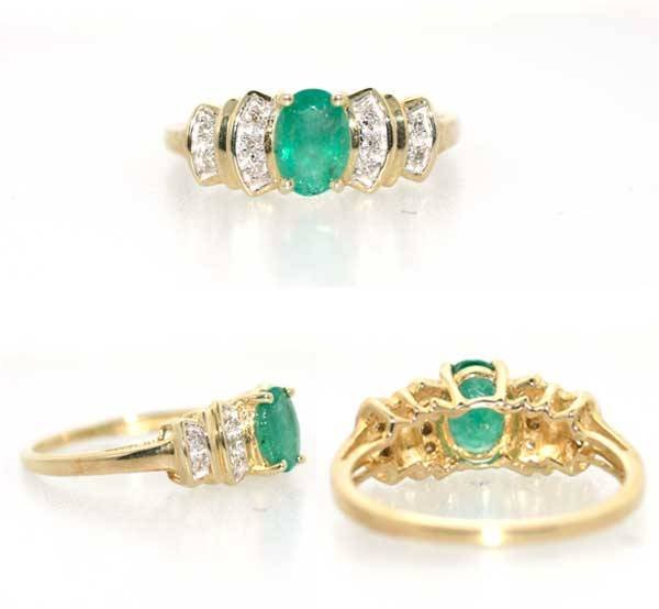 1012: 1 CT EMERALD AND DIA GOLD RING
