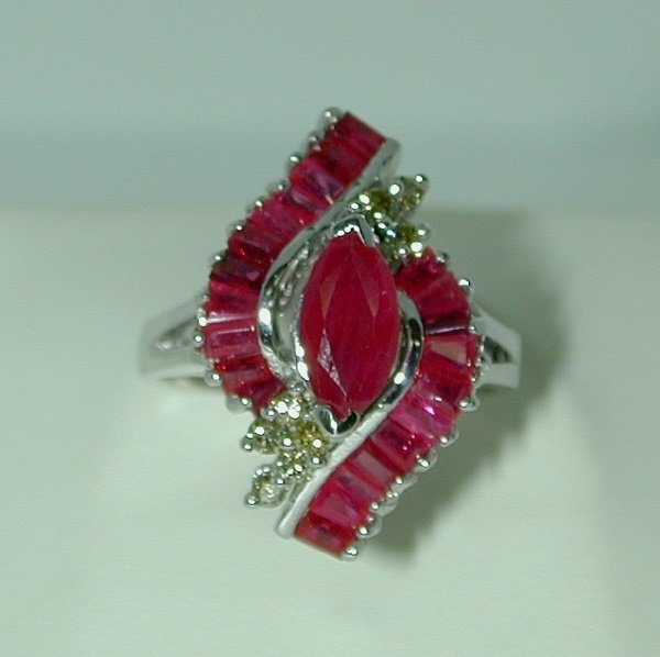 3014: 2.5 CT DIA AND RUBY 14K 6.5GR