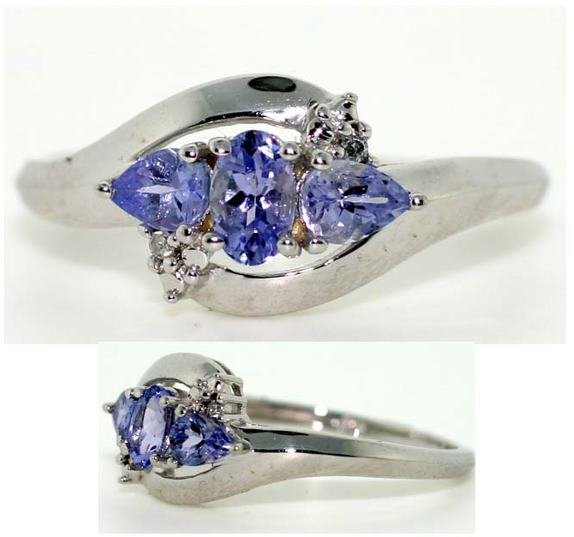 4010: TANZANITE AND DIA 2 GR GOLD