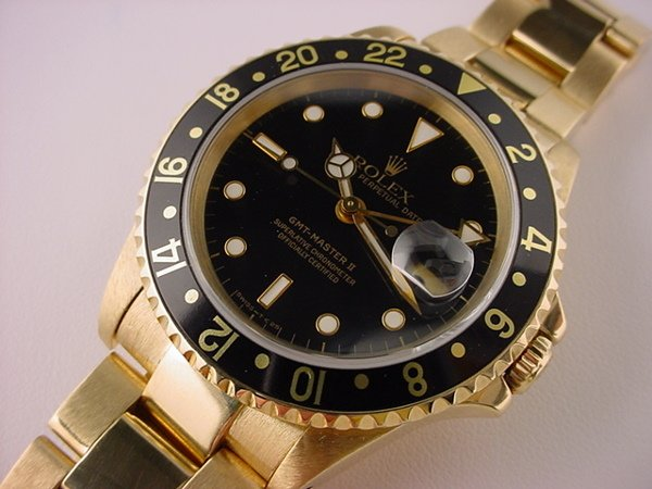 1930: Rolex GMT Master 18k Yellow Gold Black Dial Bezel