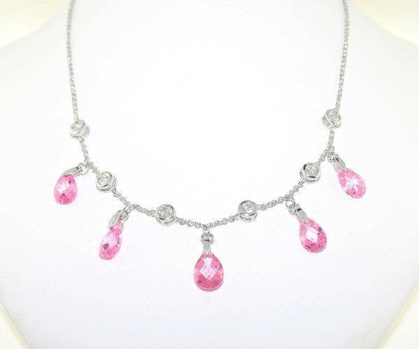 1022: 12 CT LAB WHITE AND PINK SAPP SILV