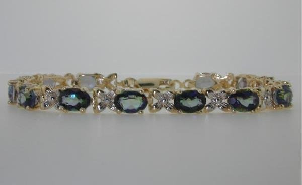 5012: 15 CT DIA AND MYSTIC TOPAZ 18K 10.5GR