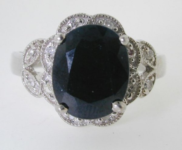 5007: 5 CT DIAMOND AND SAPPHIRE GOLD RING
