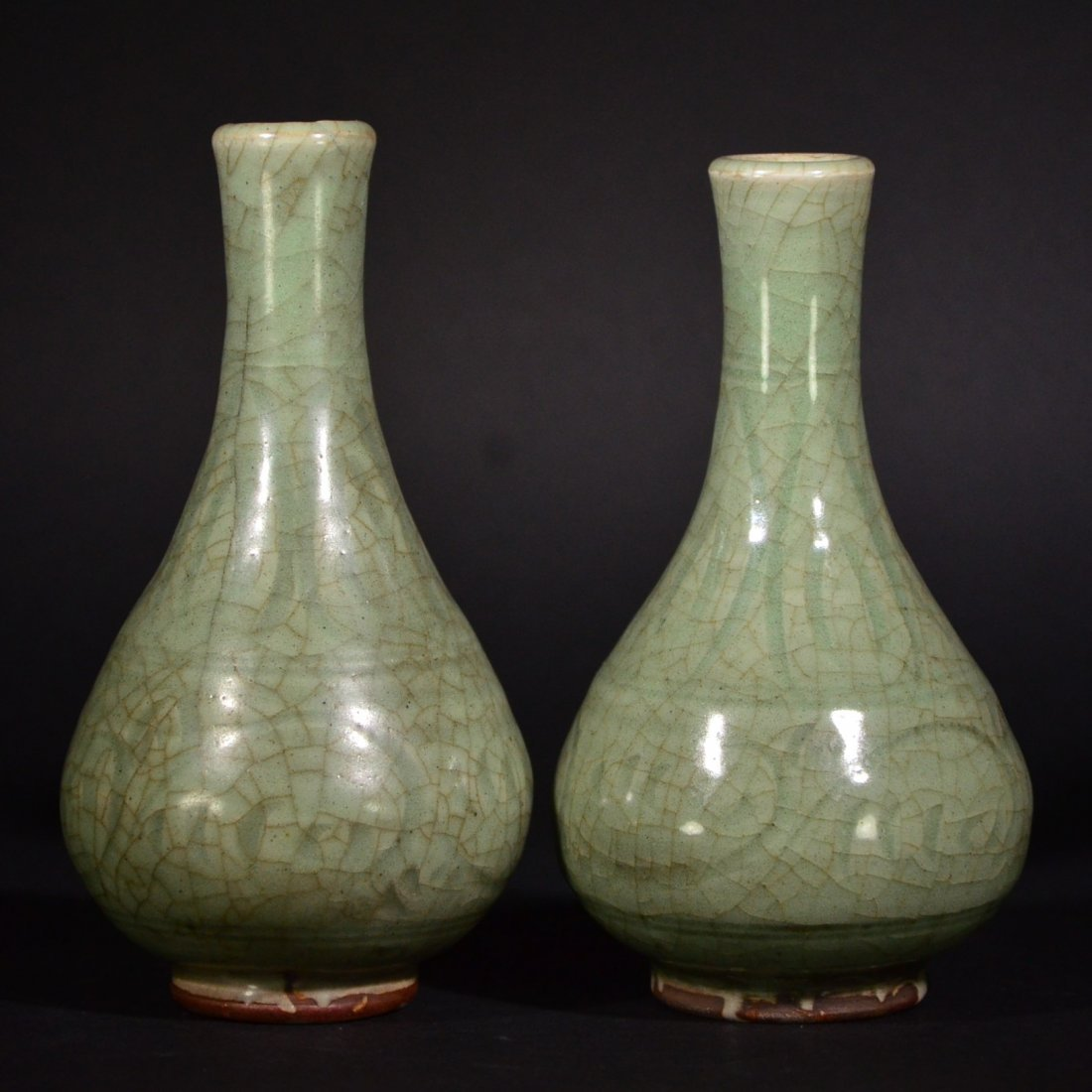 A PAIR OF LONGQUAN-KILN CARVED VASES, MING D.
