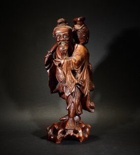 A Carved Wood Fisherman