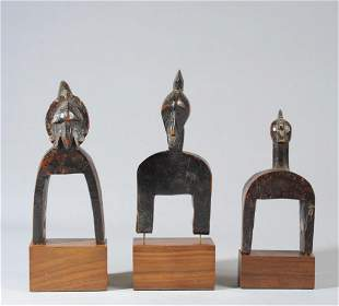 Three Senufo Heddle Pulleys